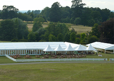 example of a temporary structure - large white clearspan marquee and pagoda marquees